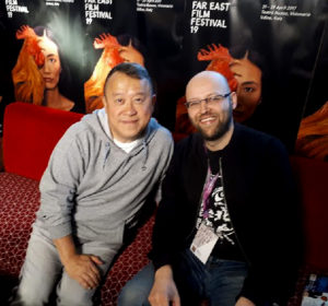 Eric Tsang and Martin Sandison get cozy.
