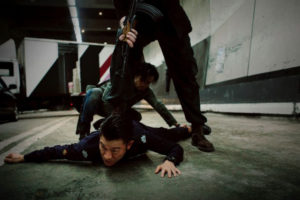 Andy Lau gets down 'n dirty in Shock Wave.